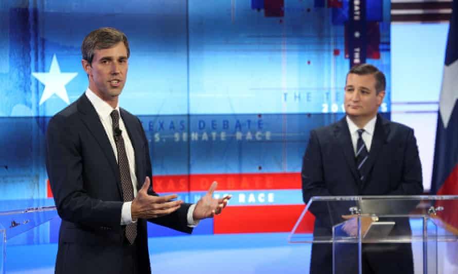 Beto O'Rourke speaks in a debate as Senator Ted Cruz looks on
