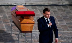 Emmanuel Macron pays his respects by the coffin of Samuel Paty during a national tribute in the Sorbonne University courtyard, Paris, on 21 October. Photograph by François Mori/ AFP/Getty