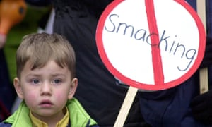 Child holding an anti-smacking placard