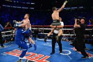 Both fighters celebrate as the final bel rings after 12 rounds.