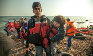 Refugees arrive on the shore.