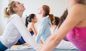 Women practising yoga in class
