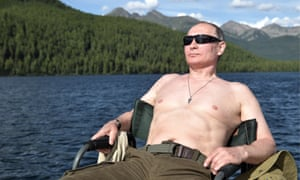Russia's president, Vladimir Putin, takes in the rays on vacation on a mountain lake in Tyva Republic
