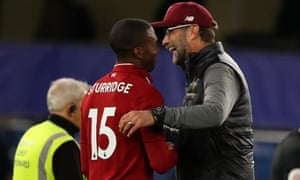 Scorer of the equaliser, Daniel Sturridge is congratulated by Liverpool manager Jurgen Klopp.