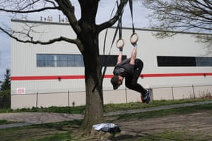 """Will Atkins works out at Rainey Park in Queens, New York. """"Normally, I would go to a gym. Since I can't, I just found a tree with a branch that works with these rings I bought. I do this four to six times a week."""""""