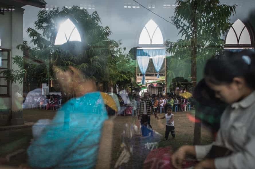 Internally displaced people and local villagers attend a church service in Myitkyina, Kachin state.
