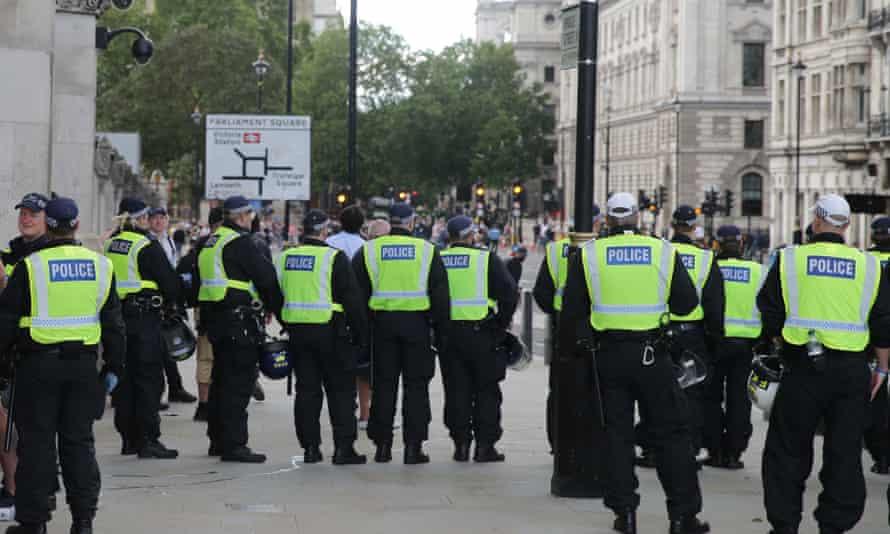 Police confront far-right protesters in Parliament Square, central London