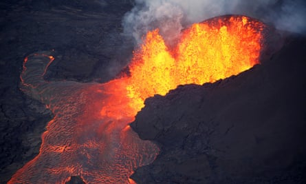 Lava erupts in Leilani Estates during ongoing eruptions of the Kilauea volcano in Hawaii 5 June 2018.