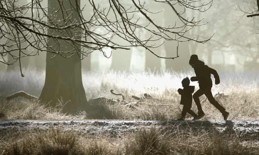 A young family enjoy a brisk early morning walk in Altrincham, United Kingdom.