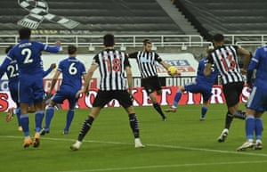 Newcastle's Andy Carroll, centre, scores his side's opening goal.