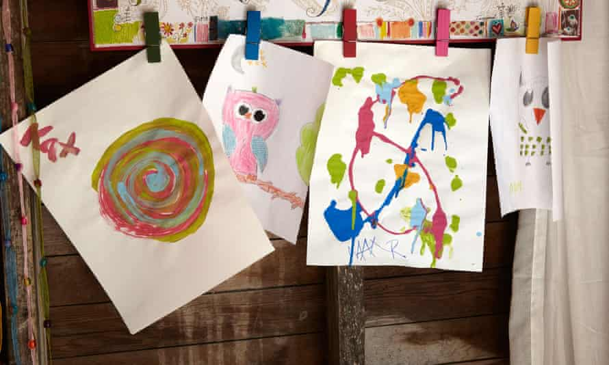Children's art work pegged up drying.