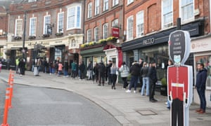 People queue outside Wetherspoon's, King and Castle pub in Windsor on Friday, following the further easing of lockdown restrictions in England. However, the hospitality bosses warned most venues had not been able to reopen outside.