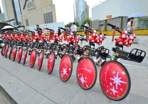 Shanghai, China Minnie Mouse-themed bicycles line a road in the city as part of a Disney/Mobike bike-sharing venture