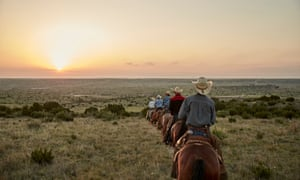 Pelham's cowboy team heads into the sunset.