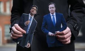Cut-out figures of Ed Miliband and David Cameron
