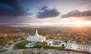 The Mormon Temple in Bountiful Utah sits above the Great Salt Lake at dusk.