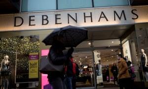 Shoppers walking past Debenhams in Oxford Street