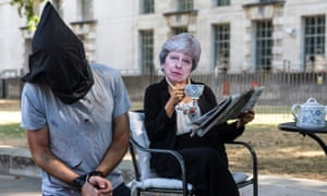 Activists posing as Theresa May and victims of torture stage in London