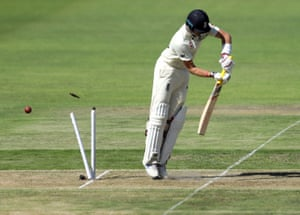 England's Joe Root is bowled out.