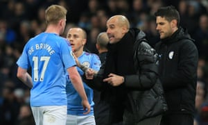 Pep Guardiola passes on instructions to  Kevin De Bruyne in Saturday's derby defeat