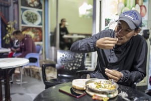 A man eats in a restaurant in central Dakhla