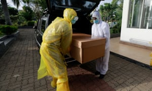 Workers carry a Covid-19 victim's body in a cardboard coffin for cremation at a cemetery, amid the coronavirus pandemic, on the outskirts of Colombo, Sri Lanka.