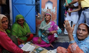 Relatives mourn the killing of 52-year-old farmer Mohammad Akhlaq at his home in Bisara.