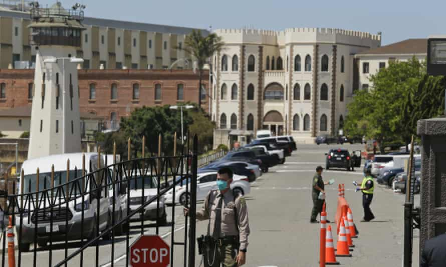 A correctional officer closes the main gate at San Quentin state prison in San Quentin, California, last month.