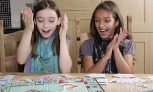 children playing Monopoly