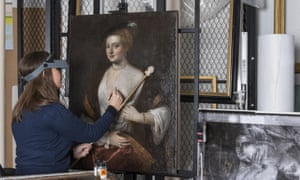 The English Heritage conservator Alice Tate-Harte working on the painting known as Titian's Mistress.