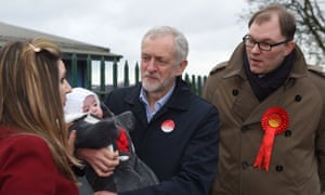 Jeremy Corbyn and Labour's Stoke Central candidate, Gareth Snell, meet local councillor Candy Chetwynd and her 17-week-old daughter, Aurelia, while canvassing.