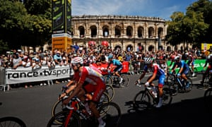 The peloton passes through Nîmes City at the start of today's stage.