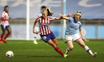 Toni Duggan (left) tussles with Manchester City's Lauren Hemp during the first leg of the Champions League tie between the two sides two weeks ago.