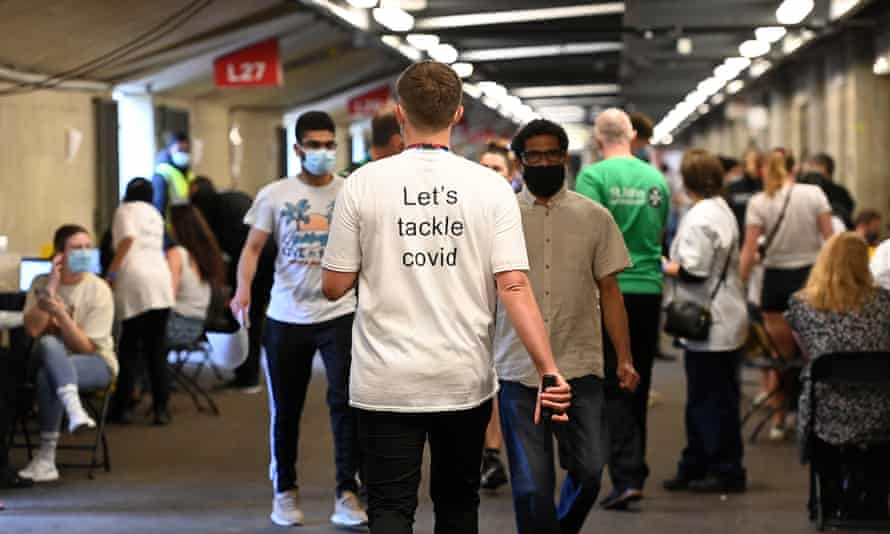 Young people wait to receive a Covid-19 vaccination jab at Twickenham rugby stadium in London