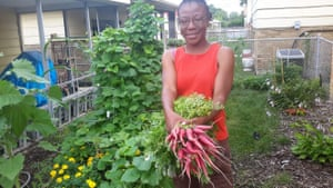 Jacqueline Smith holding some produce from her garden in Chicago, 2016.