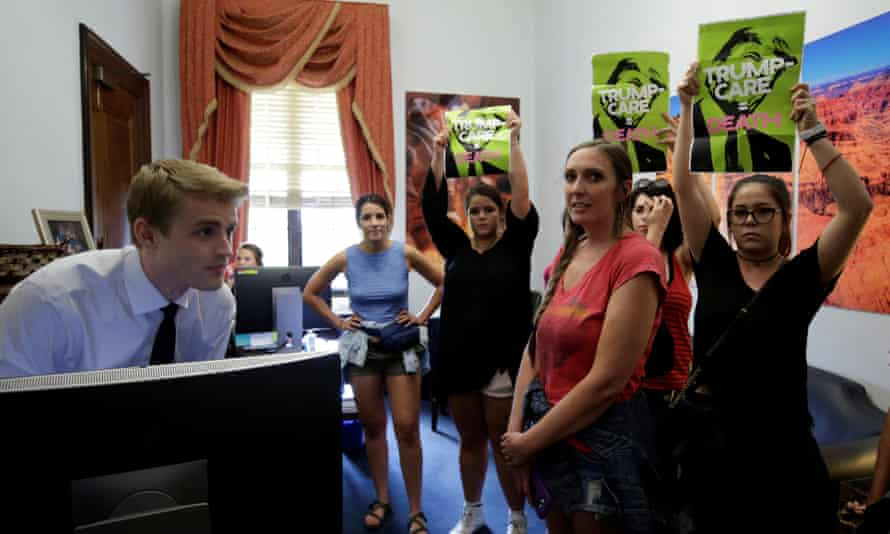 Healthcare activists protest in the office of Senator Jeff Flake earlier in July.
