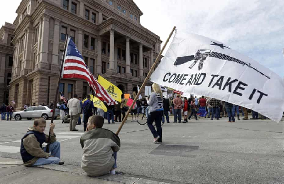 Gun rights supporters gather at a Guns Across America rally at the Texas state capitol in 2013.