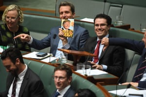 Tim Watts holds up a book by Donald Trump, that had been left in George Christensen's seat