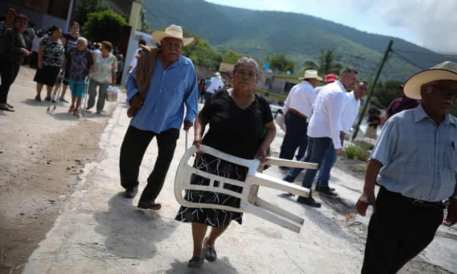 Residents of the town walk home after a speech by the state governor, Miguel Barbosa.