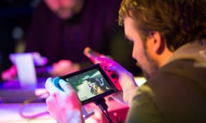 Gamers playing Super Mario Kart 8 Deluxe during the presentation of the new Nintendo switch 'Nintendo Switch' launch in Paris. A game that isn't out yet.