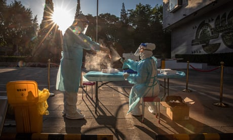 Coronavirus live news: South Korea may return to restrictions after cases spike as US deaths pass 100,000