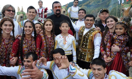 Steven Seagal and people in traditional dress in a specially built village, Kyrchin, at the games.