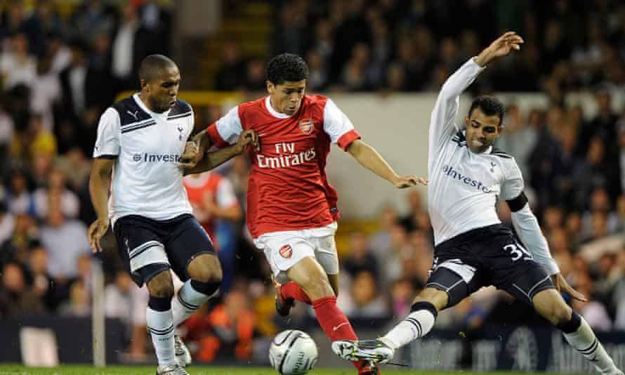 Denílson in action for Arsenal, getting between Tottenham's Wilson Palacios (left) and Sandro in a Carling Cup third-round tie in September 2010.