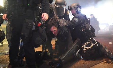 Police clash with protesters outside the police department's north precinct in Portland, Oregon.