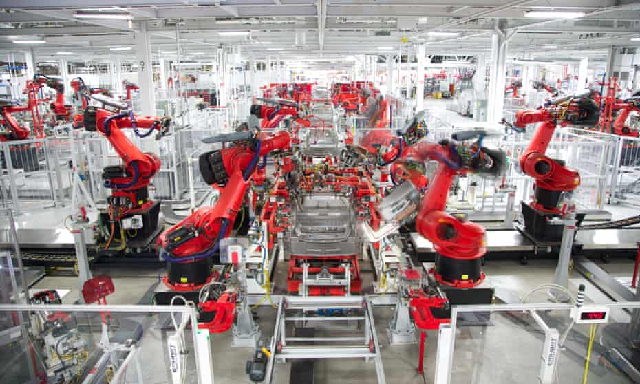 Inside Tesla's car-production center in Fremont, California. The factory employs some 10,000 workers.