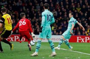 Ben Foster's leg denies Arsenal's Henrikh Mkhitaryan.