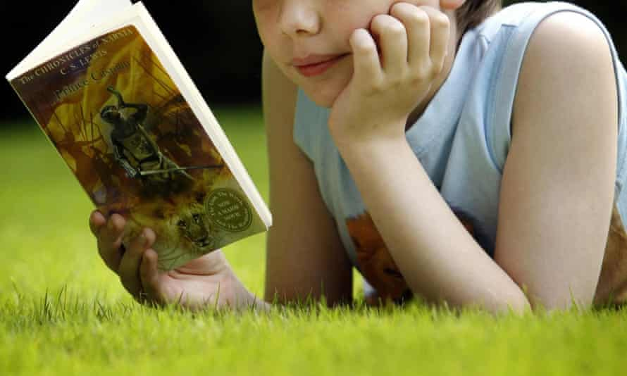 A child reading CS Lewis's Prince Caspian. The writer John Boyne says: 'I've grown less concerned with  how young people read and more fanatical about just getting them to read at all.'