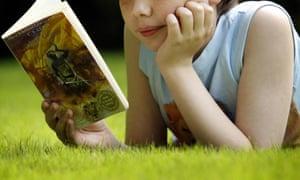 A boy reads a book