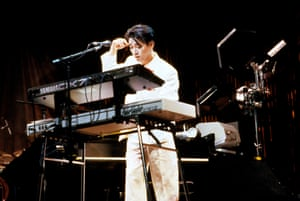 Ryuichi Sakamoto playing a Fairlight CMI Series III sampling synthesiser and a Yamaha DX7 keyboard.