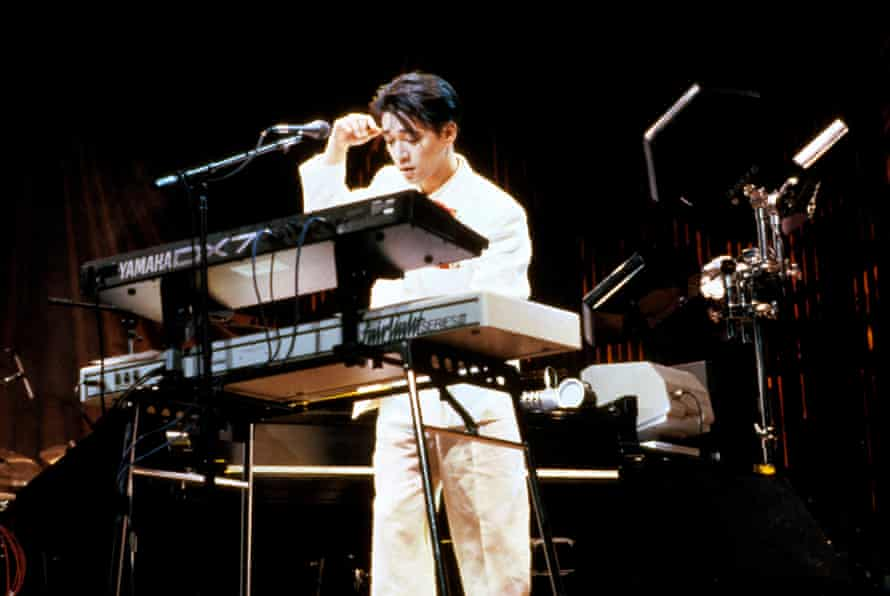 Ryuichi Sakamoto playing a Fairlight CMI Series III sampling synthesiser and a Yamaha DX7 keyboard.